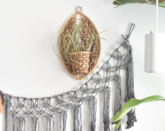 mid century modern teardrop woven rattan bamboo wall hanging basket planter | wall pocket