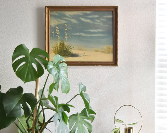framed original vintage painting of blue skies andy beach landscape with flowers