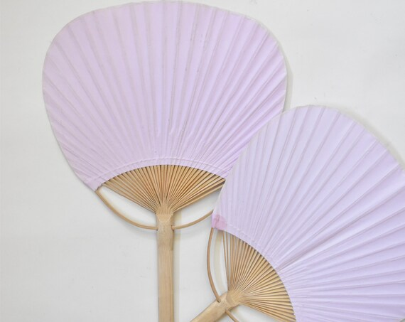 pair of soft pink purple carved wooden paper fans
