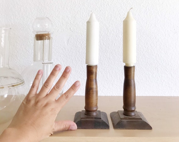 pair of mid century modern turned natural wood candleholders / candlestick holders