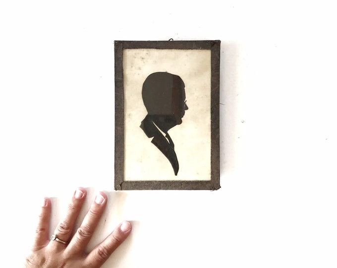 framed black antique hand cut silhouette of man doctor