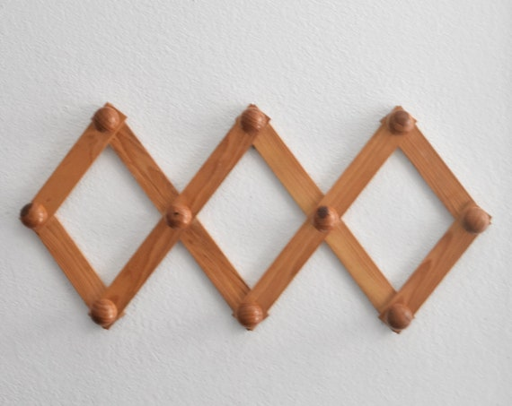 large bulky vintage wood accordion wood peg wall hanging rack // hat display storage // organizer