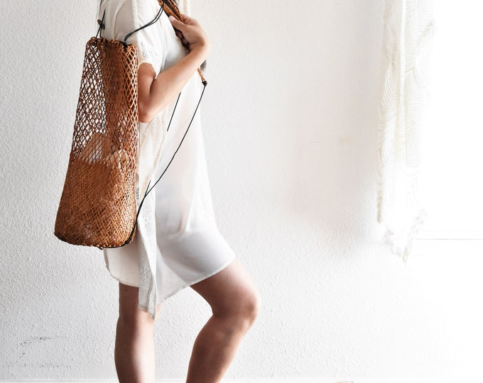 woven rattan bamboo traveling drawstring backpack / tote purse