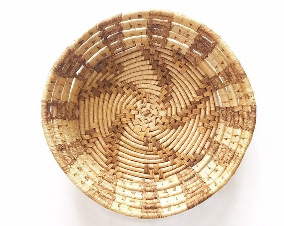 bohemian style coiled woven straw wall hanging basket with swirl star pattern