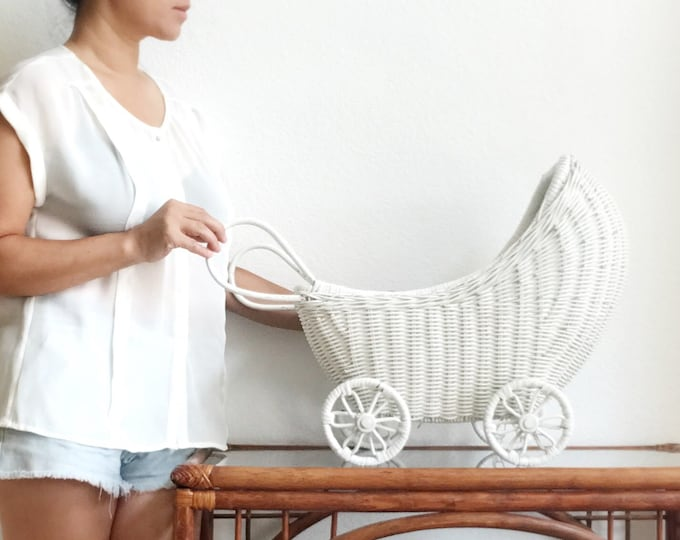 white woven wicker rolling toy buggy carriage   baby doll tram