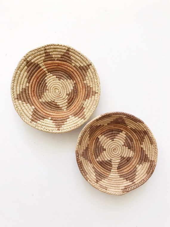 pair of coiled woven straw wall hanging baskets / set of 2 star shaped african baskets