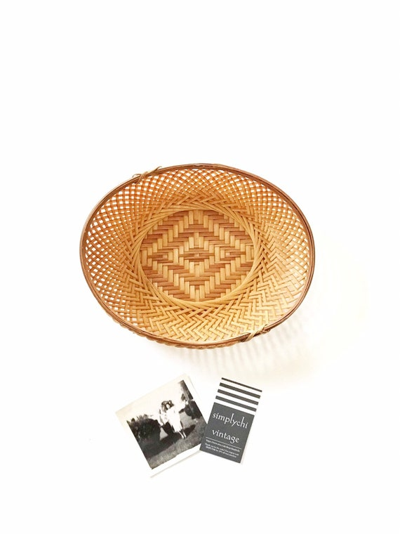 mid century modern oval wall hanging vintage woven rattan basket with geometric pattern