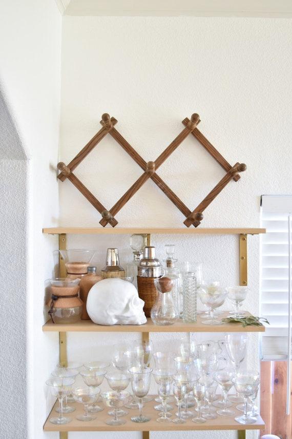 mid century large bulky vintage wood accordion wood peg wall hanging rack / hat display storage / organizer