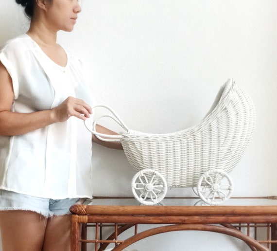 white woven wicker rolling toy buggy carriage | baby doll tram