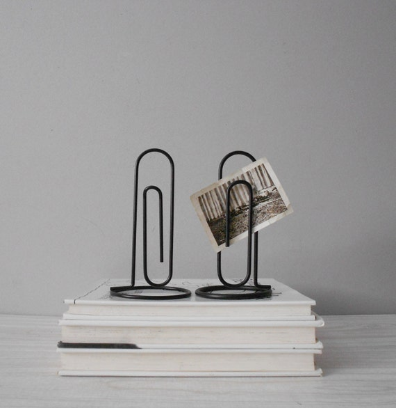 single large vintage black office paperclip photo stands