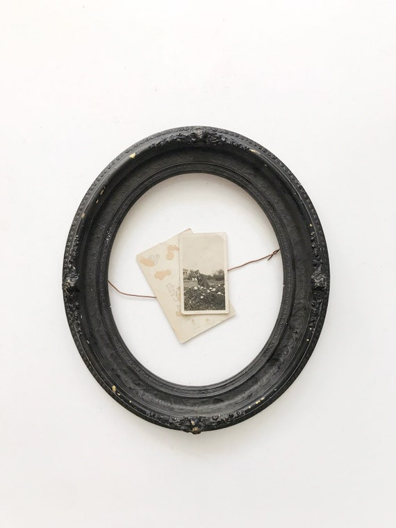 antique ornate black oval wooden wall hanging picture frame