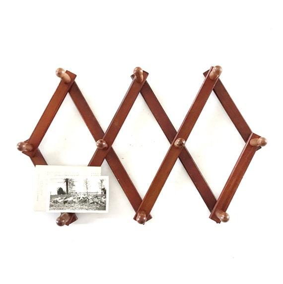 accordion wood peg wall hanging rack // hat display storage // organizer