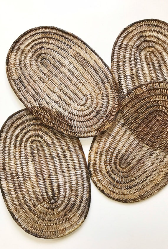 brown oval shaped boho woven straw wall hanging basket serving placemats / set of 4 trivets