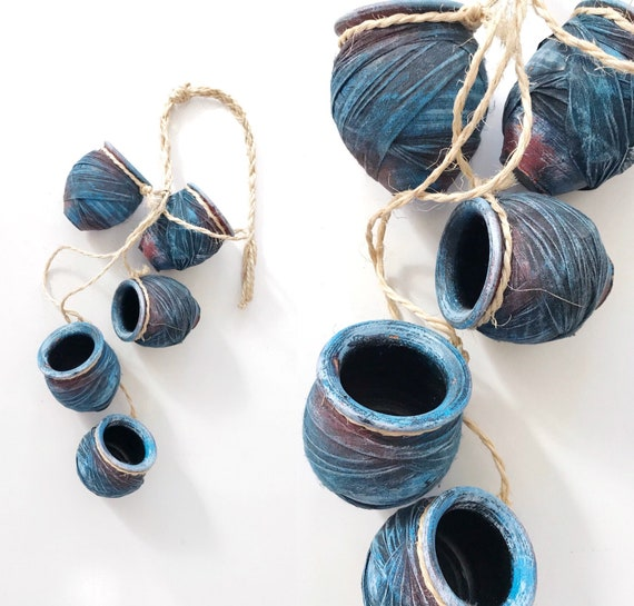 small blue pottery vases on a string | clay flower pots