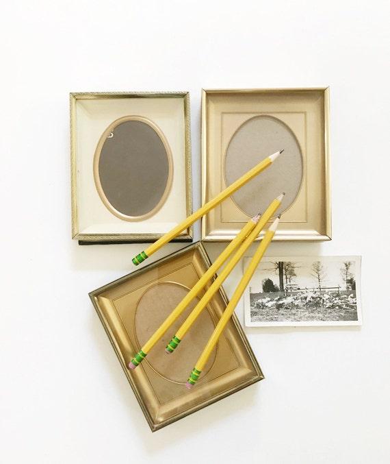 set of vintage brass oval picture frame / standing / easel / set of 3