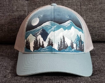 382237a6fe7a5 Hand painted mountain tree view design trucker cap.