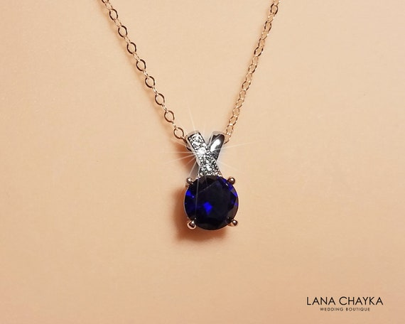 18-Inch Rhodium Plated Necklace with 4mm Sapphire Birthstone Beads and Sterling Silver Air Force Diamond Charm.