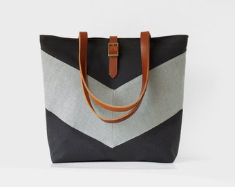 GrayBlue linen chevron, Dark navy tote / diaper bag / shoulder bag, leather handles. 9 inside pockets. Waterproof poly lining available