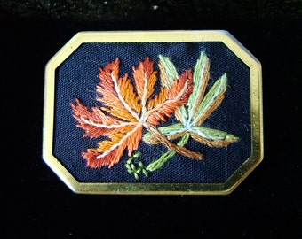 Hand embroidered brooch. Autumn leaves design.