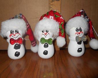 3 small wooden snowmen ornaments.