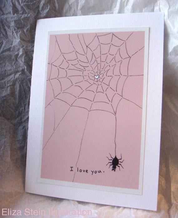 Soft pink spider web knitted artwork.