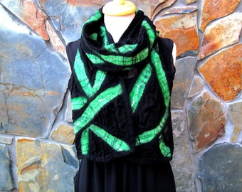 Wide nuno felt scarf on black silk with a green abstract line design