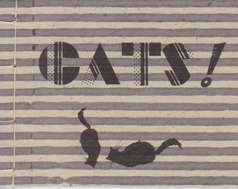 """Cats--An illustrated book of quotations by famous authors. Sample: """"The dog did it."""""""