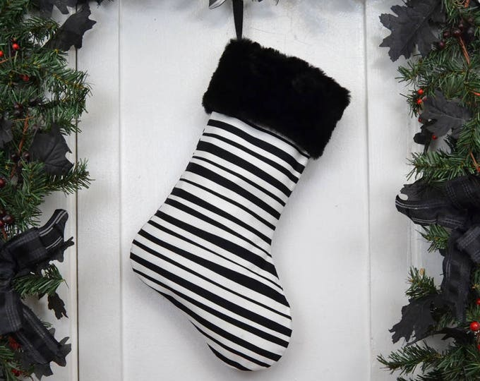 Black and White Horizontal Stripe Christmas Stocking with Black Faux Fur