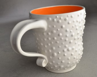 Dottie Coffee Mug Ready To Ship White Orange Coffee Tea Curvy Dottie Mug by Symmetrical Pottery CDMWO1