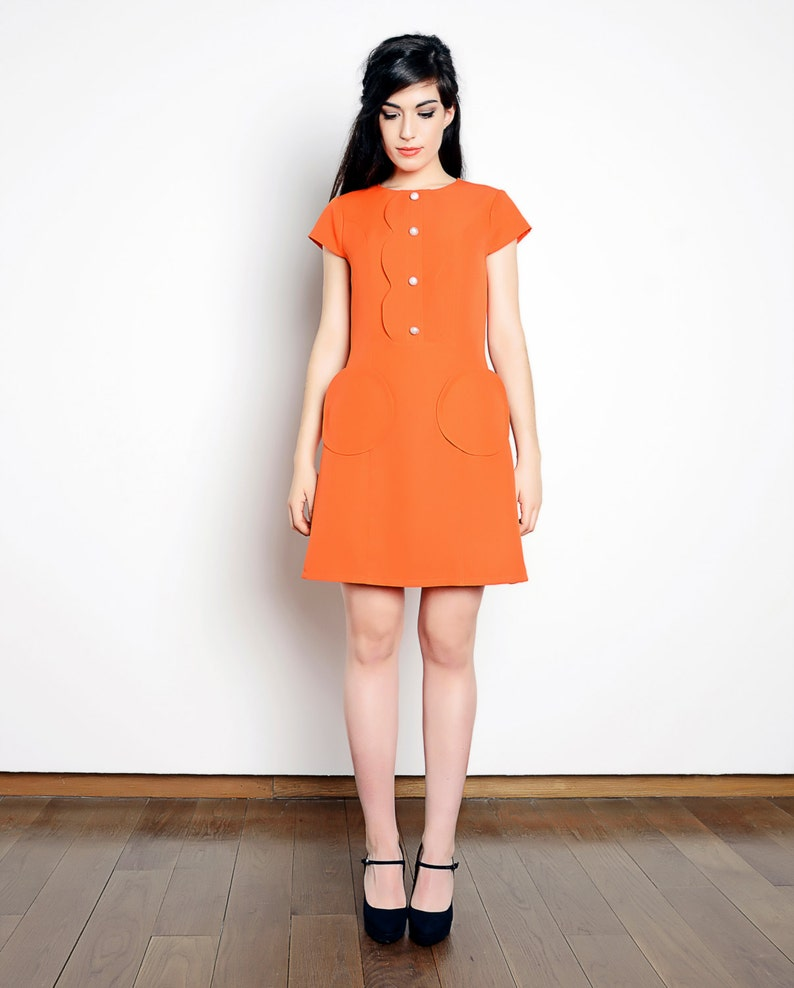 60s Dresses | 1960s Dresses Mod, Mini, Hippie 60s orange dress Mod dress round pockets dress A line dress 1960s dress scooter dress ruffle collar $160.00 AT vintagedancer.com