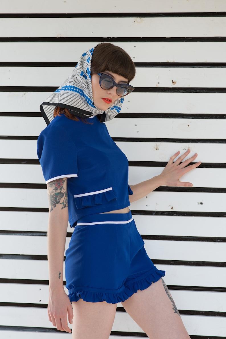 1960s Women's Outfit Inspiration Blue ruffle shorts 1960s Mod mini culotte $142.00 AT vintagedancer.com
