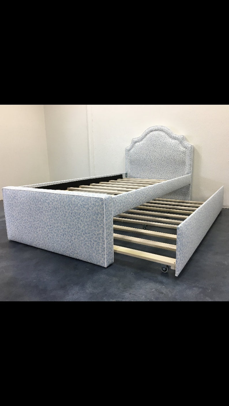 Upholstered Bed w/ Curved Headboard & Rolling Trundle image 0