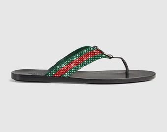 8fa8eb997d8698 Gucci Web strap thong sandal
