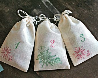 Advent calendar set.  24 muslin drawstring bags. Reusable advent countdown set. Rustic chic decoration for the holidays. Red and green.