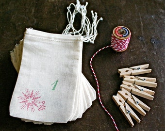 Advent calendar kit, 24 muslin drawstring bags. Reusable advent countdown set, plus baker's twine and clothespins for display.