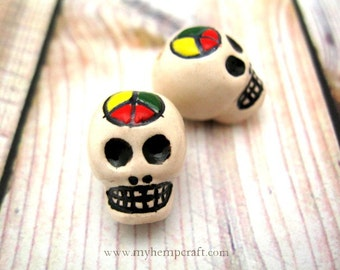 Skull Beads, Rasta Peace 2pc White Day of the Dead Decorated Skulls, 27x24mm