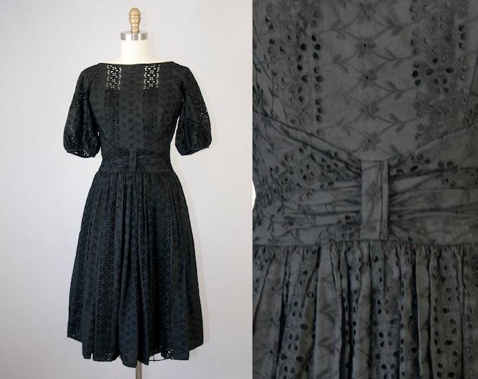 """1960s Vintage Black Eyelet Cocktail Dress (S; 26"""")"""