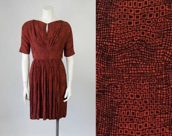 60s Vintage Black and Rust Geometric Print Rayon Dress with Swing Panel Skirt (XS)