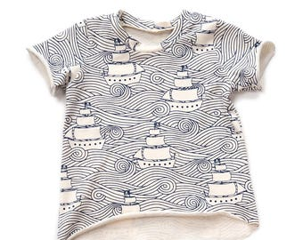 Edgy tee sewing pattern for babies and toddlers, sizes from 0-3m to 5-6T, pattern 106 includes layers
