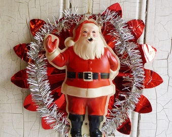 mid century celluloid santa claus tinsel wall hanging red aluminum foil star kitschy 1950s christmas decoration kitschmas