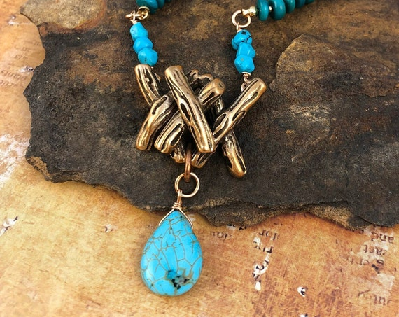 Twig pendant with Turquoise. Strung on 4.5mm turquoise beads. Closure is hook and eye.