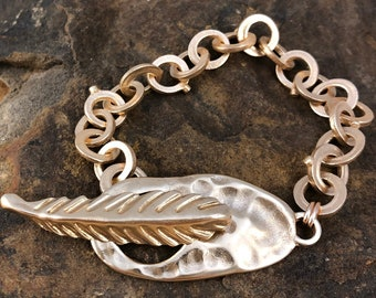 Sculpted chunky chain bronze bracelet with Feather Toggle