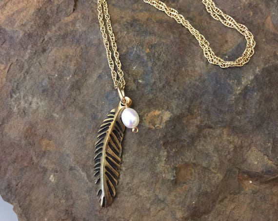 Small sculpted bronze feather