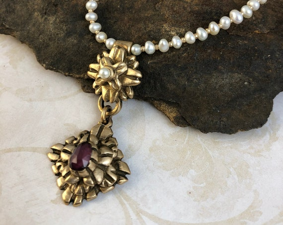Historically Inspired bronze pendant necklace with grape garnet and freshwater pearls.