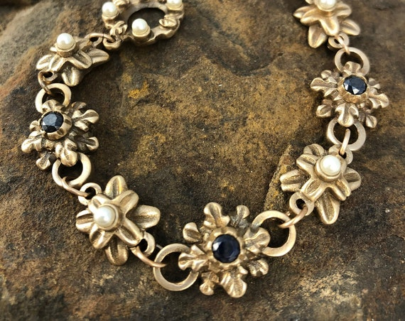 Historically inspired link bracelet with sapphires and pearls.