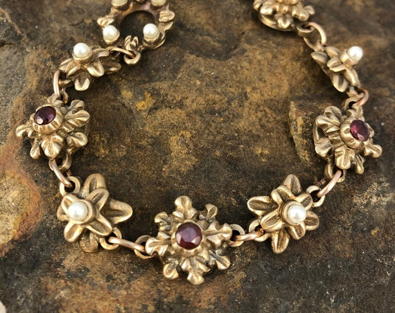 Historically inspired link bracelet with garnets and pearls.