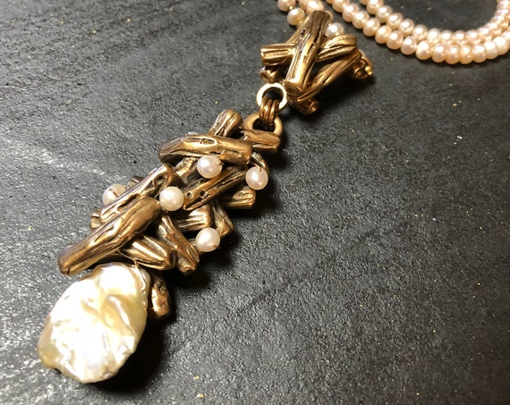 Sculpted bronze twigs with freshwater pearls
