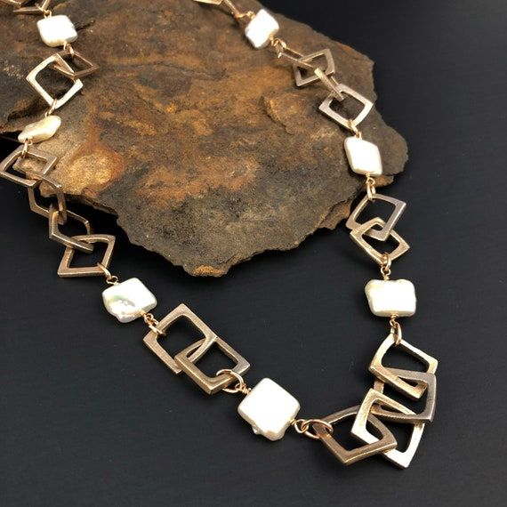 Square link chain with square freshwater pearls.