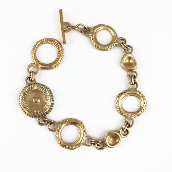 Bronze ring and disc bracelet