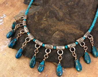 Turquoise drop Necklace with bronze twig themed beads. Strung on 4mm turquoise beads. Closure is hook and eye.
